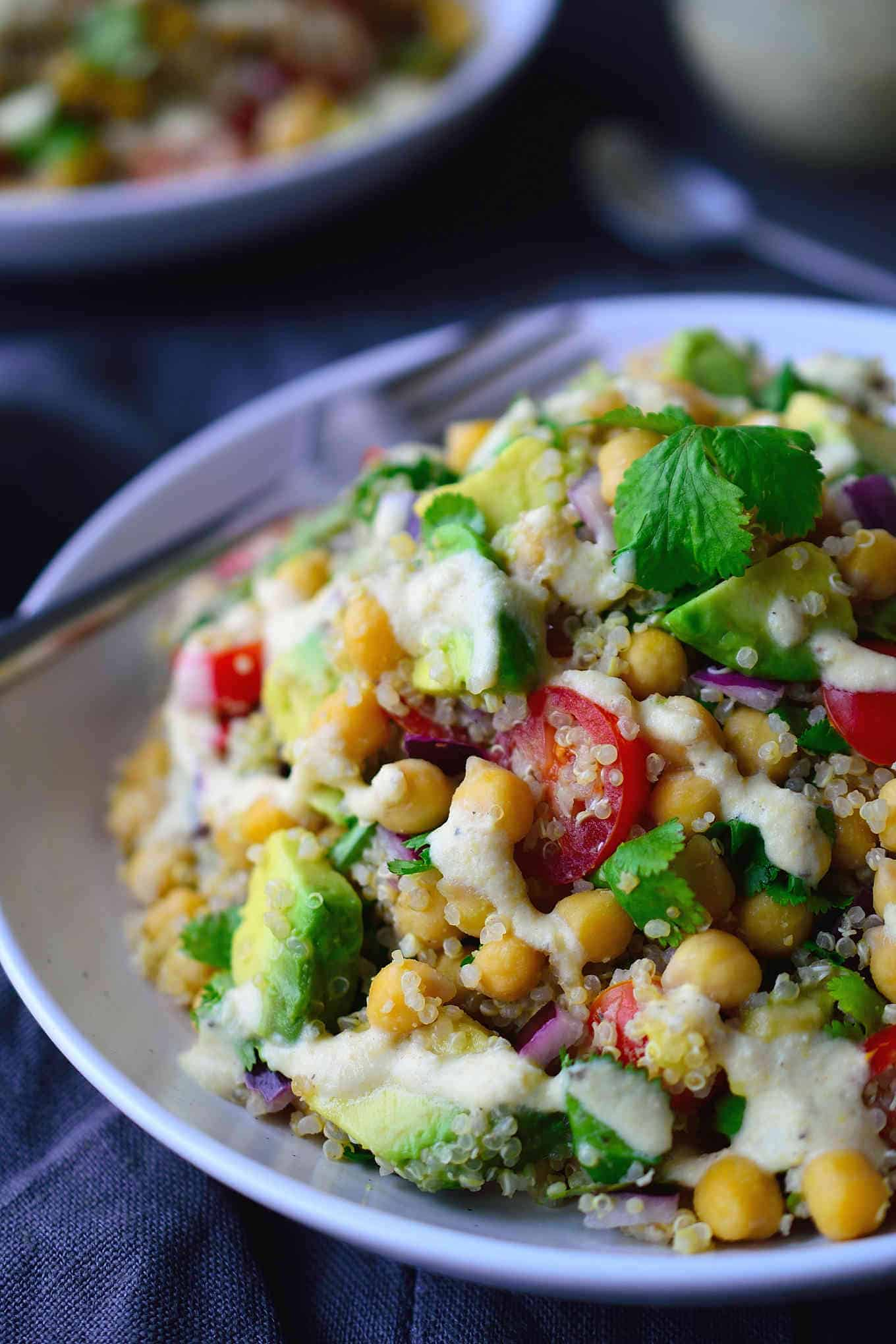 This chickpea avocado salad is super easy to make and great for a weekday lunch, side dish or to take to a potluck, picnic or BBQ. You can choose to serve this salad as-is with a squeeze of lemon juice, or whip up a creamy vegan dressing to drizzle over top. Either way it's a hearty, protein-packed and delicious salad that will keep you full for hours!