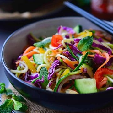 This raw vegan noodles salad recipe is super quick and easy to put together and is great served as a main or side dish. All you need is a selection of colourful vegetables, some pantry staples and a spiralizer.