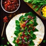 These samosa wraps are super easy to put together with spiced potatoes and peas, crisp greens, spicy red onion and a simple homemade mango chutney. Make these samosa wraps ahead and freeze them for a quick lunch (or dinner) throughout the week.
