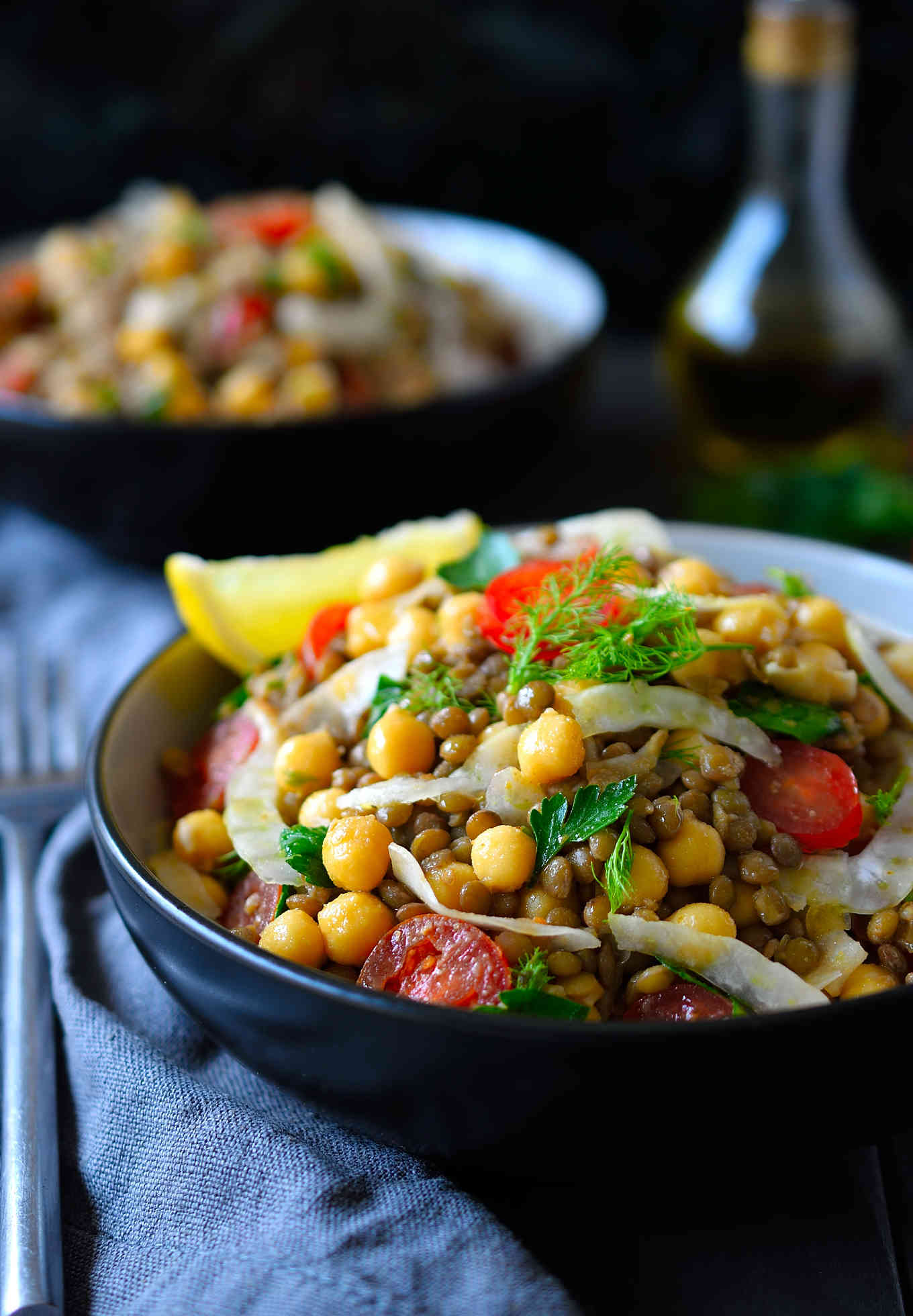 This bean and lentil salad recipe features chickpeas and lentils tossed with sliced tomato, fennel and herbs in a simple yet flavourful coriander-cumin lemony dressing. It's easy to put together and keeps well in the fridge for later. Serve this delicious salad as a side or hearty main dish, take it to a potluck, BBQ or picnic.