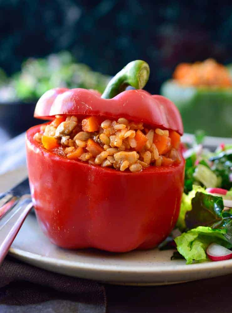 Vegan stuffed peppers are an all-time family favourite. They're easy to make, adaptable to whatever you have on hand and can be made ahead for a quick dinner with minimal prep. With a cheap filling of rice, mushrooms and carrots, these stuffed peppers are perfect for a filling meal on a budget.