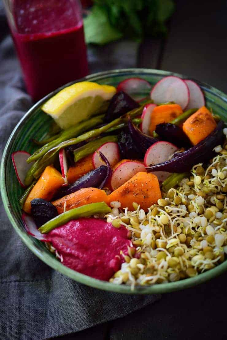 This sprouted lentil vegan Buddha bowl is hearty and flavourful with roasted vegetables and a creamy beet and tahini sauce. Easy to make and packed with the nutritional goodness of sprouted lentils, this vegan Buddha bowl is budget friendly at only $1.62 a serving!