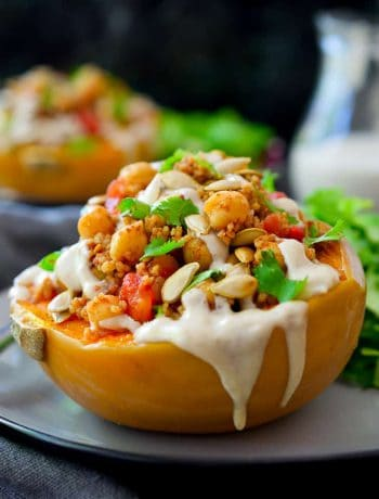 This vegan stuffed squash is a whole meal in just one dish. Hearty and flavourful roasted squash is filled to the brim with couscous and chickpeas tossed in a mix of delicious warming spices and topped off with a tasty tahini-date sauce. An impressive and flavourful vegan or vegetarian main dish for just $1.70 a serving!