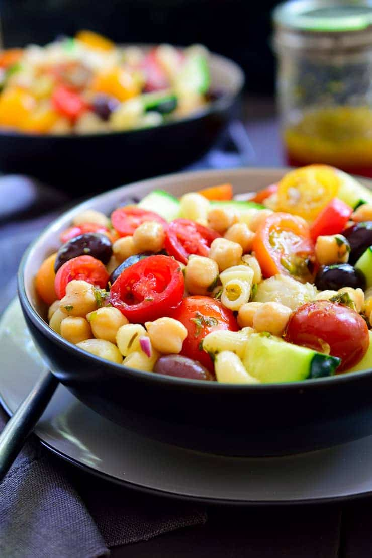Easy and delicious Mediterranean chickpea salad with fresh vegetables, pasta and hearty chickpeas.