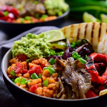 This vegan Mexican rice fajita bowl is full of flavour with a base of tomato rice, grilled vegetables and a dollop of guacamole. Easy to make and hearty, these bowls can be made ahead to pack for lunch and cost just $1.80 a serving!