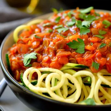 This lentil bolognese recipe is unlike any you've had before. Flavoured with loads of garlic, herbs and smoked paprika, this sauce is delicious served over crisp zucchini pasta. Easy to make with cheap ingredients (as always!), this dish comes together in just 15 minutes!