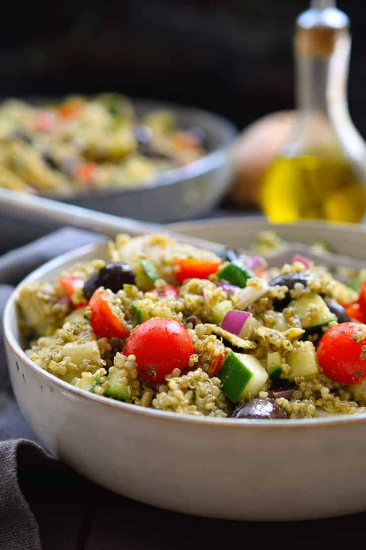 This pesto quinoa salad is quick and easy to make, packed with flavour and a rainbow of Mediterranean veggies. The perfect weeknight dinner when you don't feel like cooking or a great picnic, potluck or barbecue side dish!
