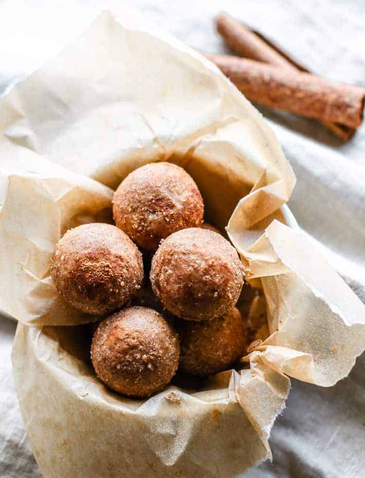 A parchment-lined bowl of breakfast protein balls.