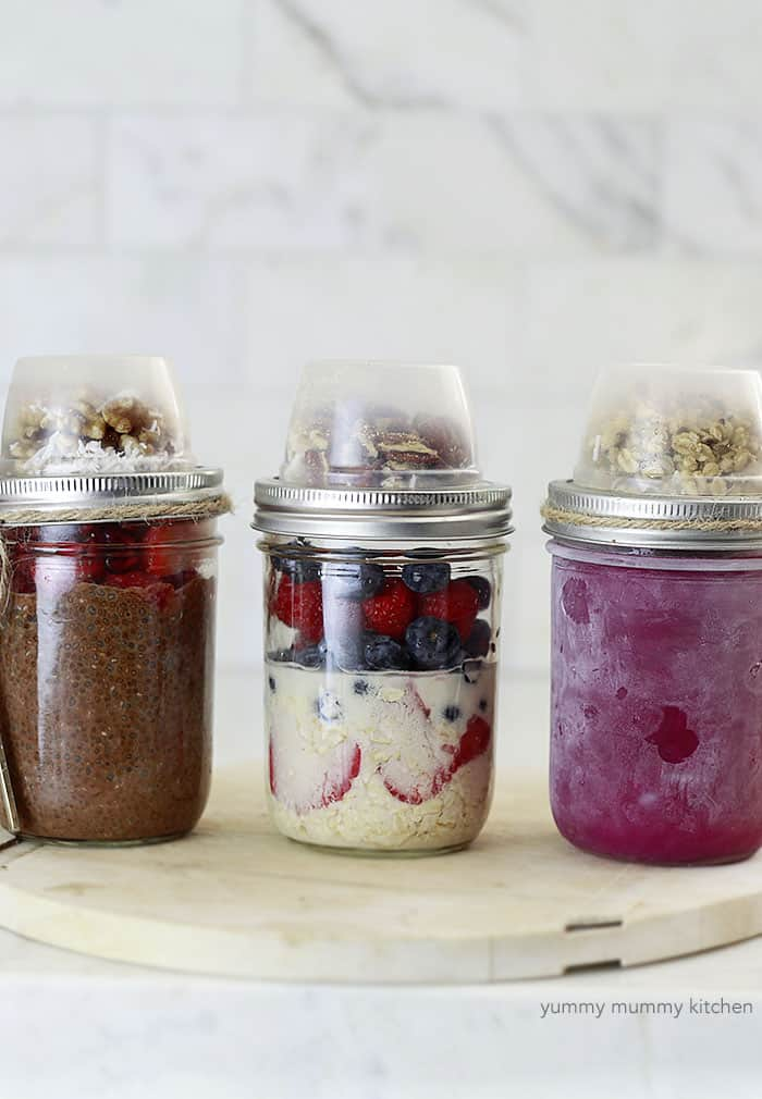 3 mason jars with a smoothie, chia pudding and oats.
