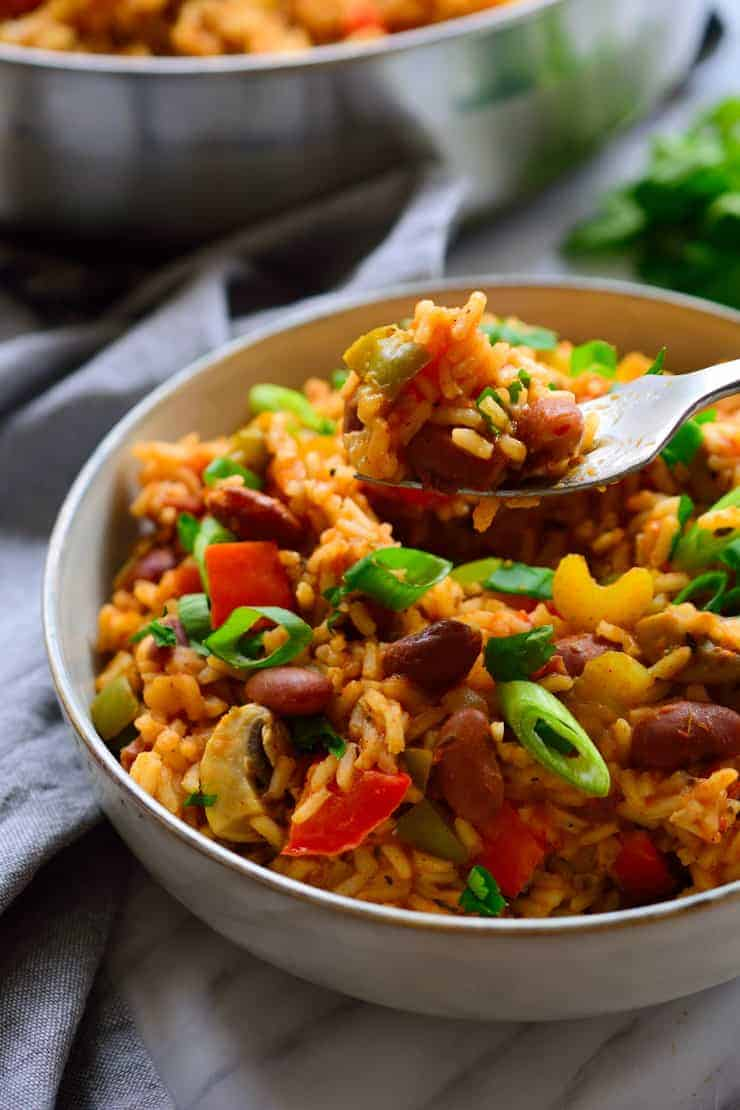 Vegan jambalaya in a bowl with a fork in it.