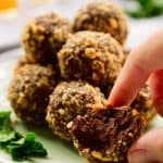 Vegan mint chocolate truffles rolled in crushed hazelnuts.