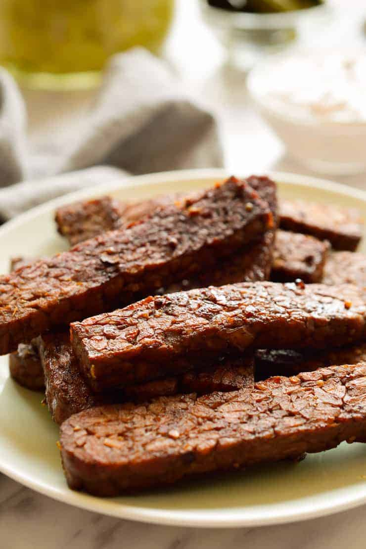 Seasoned tempeh on a plate.
