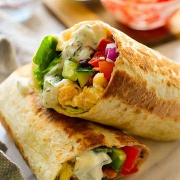 Rolled up vegan Mediterranean wraps.
