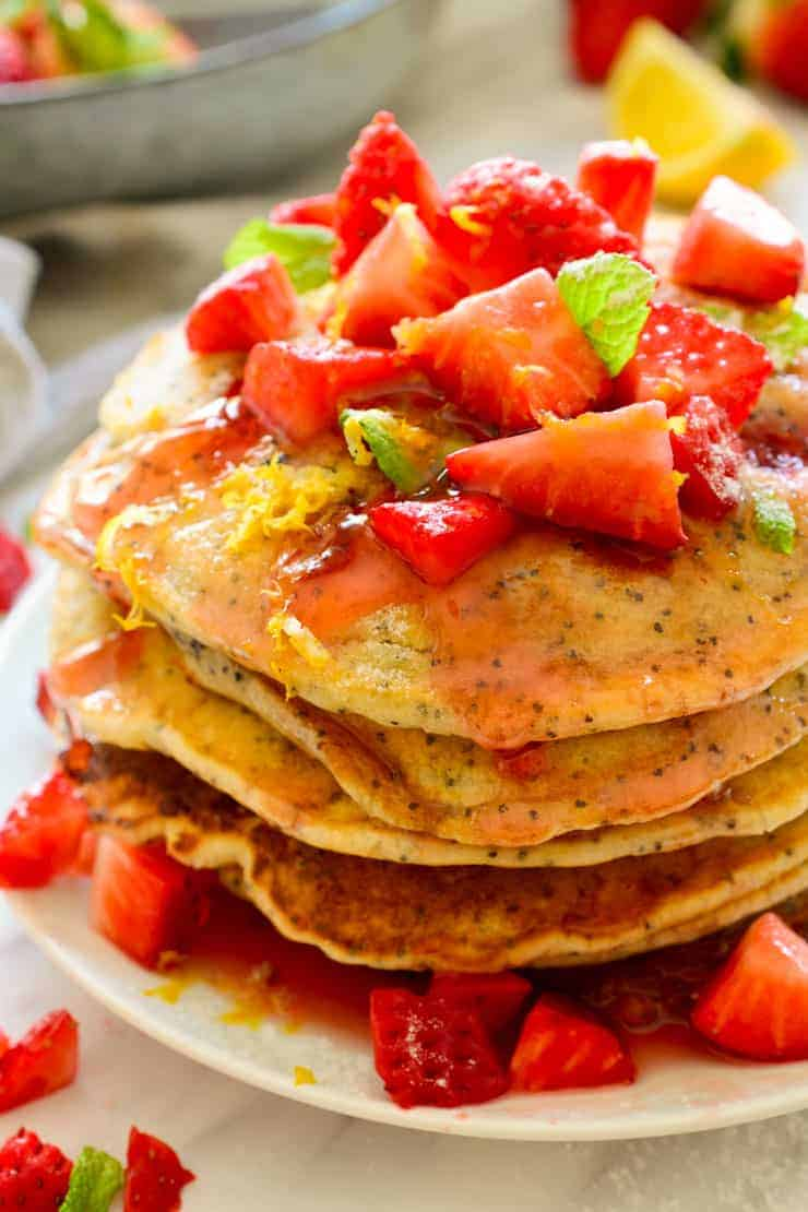 A stack of vegan strawberry pancakes viewed from the top.