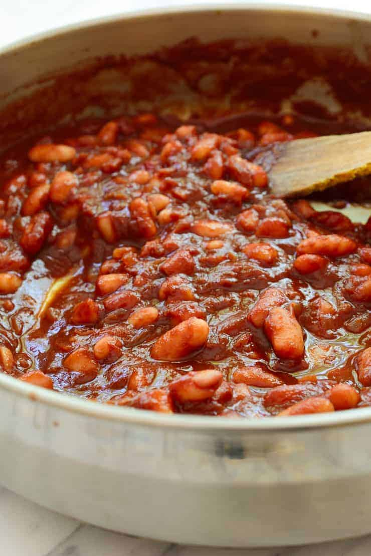 Smoky vegan beans cooked in a pan.