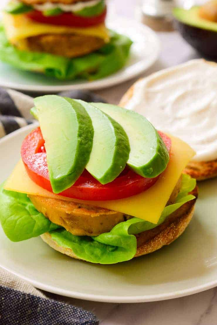 Vegan breakfast sandwich open on a plate.