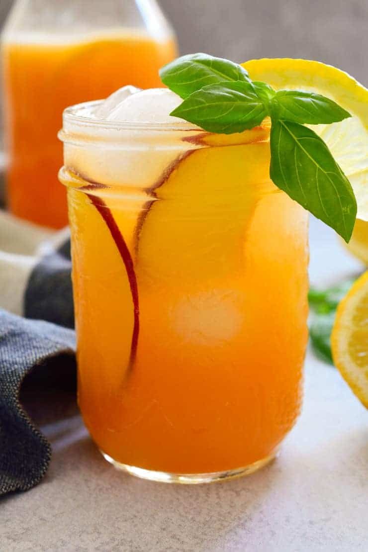 Peach nectar lemonade in a mason jar with peach slices.