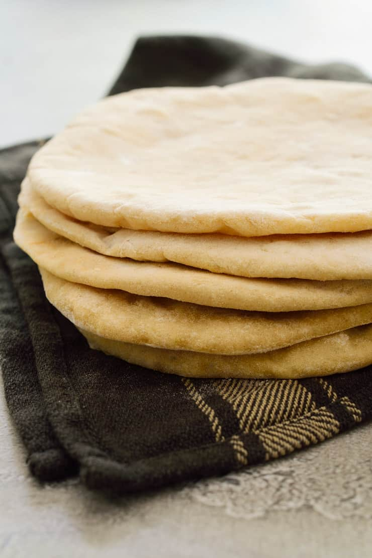 Fresh pita bread on a towl.