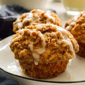 Vegan banana crumble muffins on a plate.