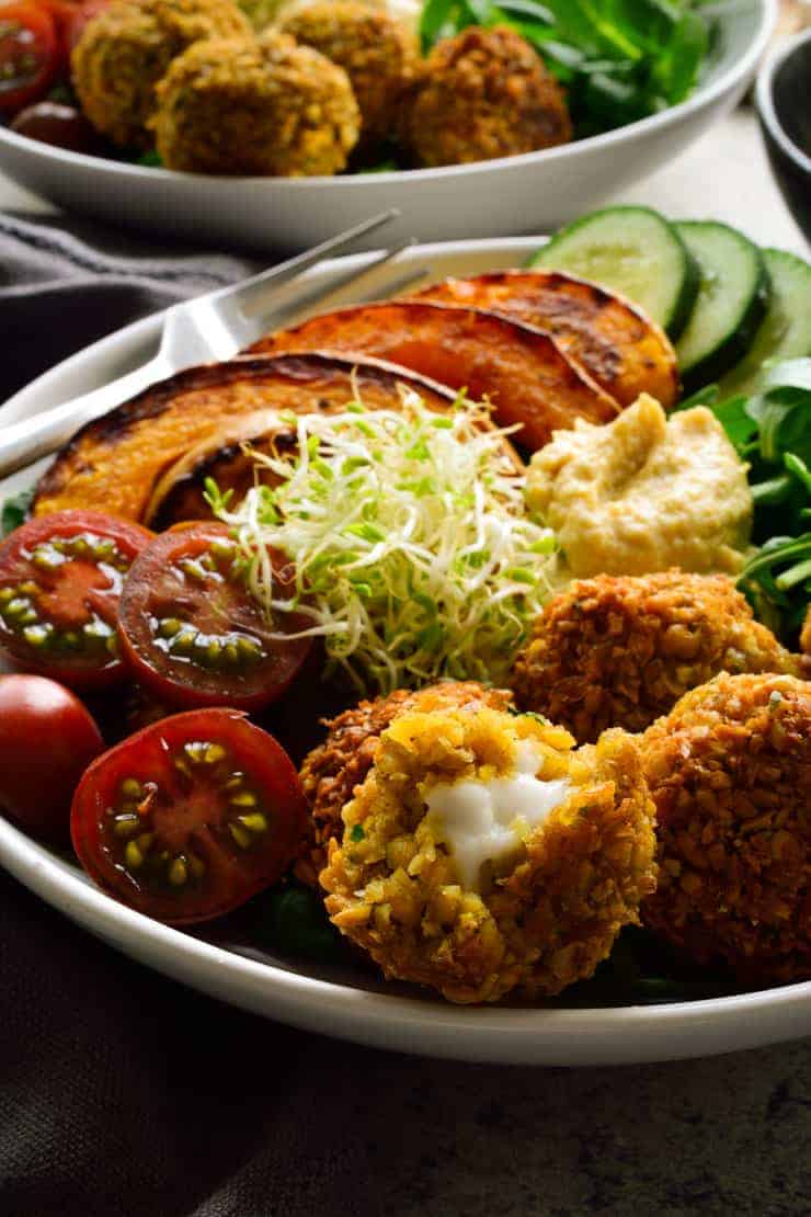 A Buddha bowl featuring stuffed vegan falafel.