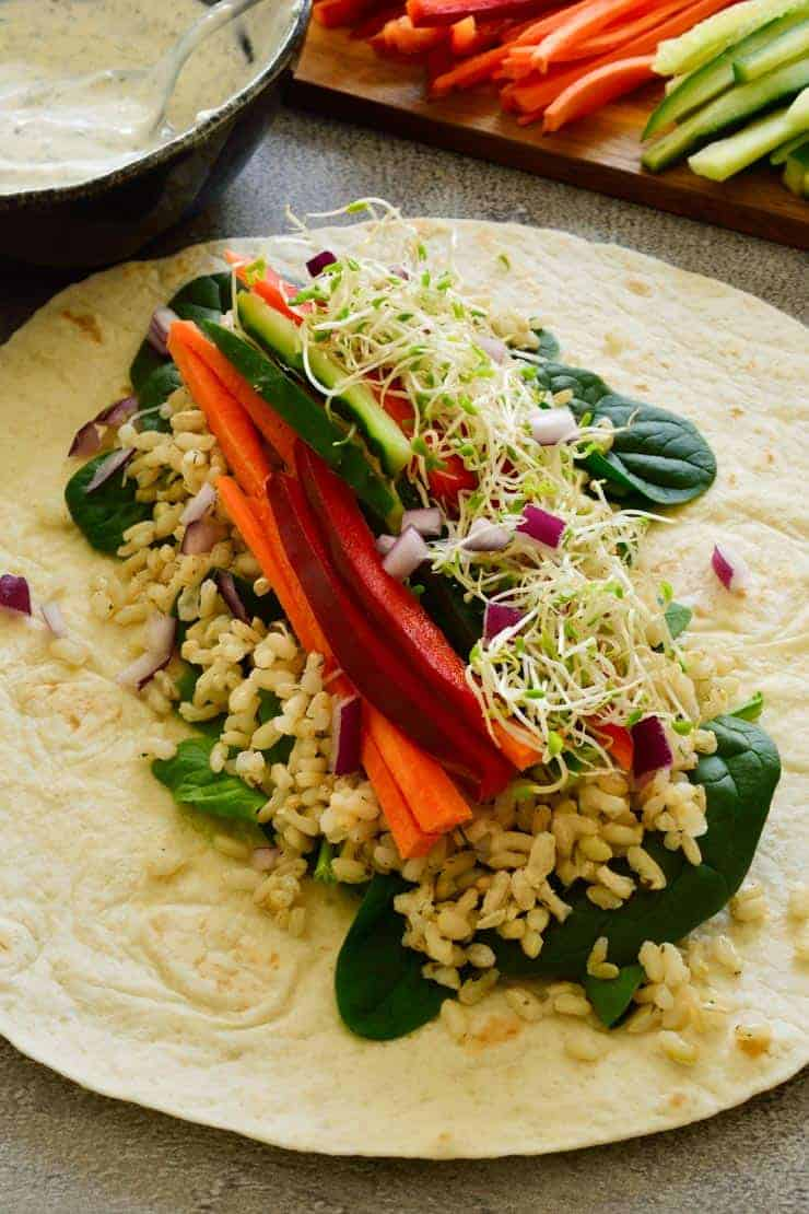 Ranch veggie wrap open on the table.