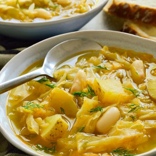Two bowls of vegetarian cabbage soup.