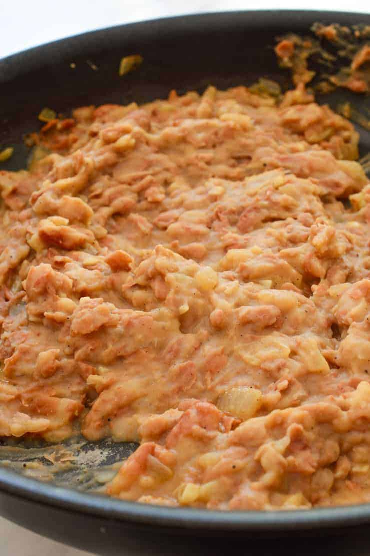 The pan of mashed beans.