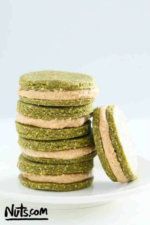 5 pistachio cookies on a white plate.