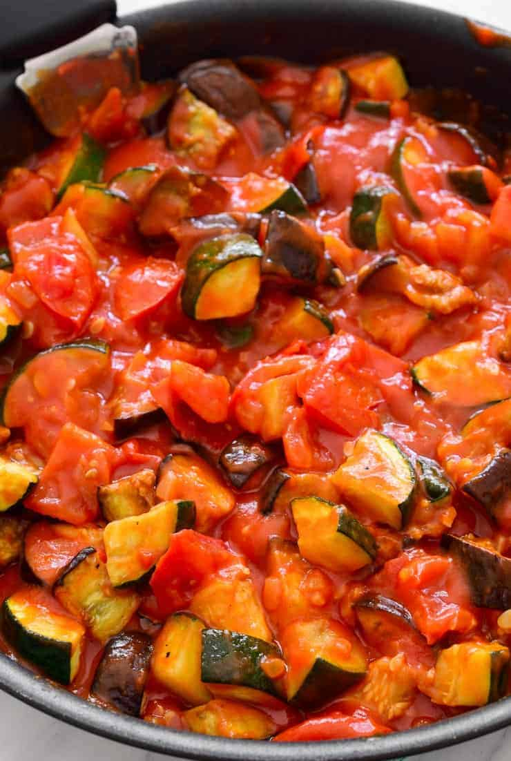 The pan of sauce with the roasted vegetables added to it.