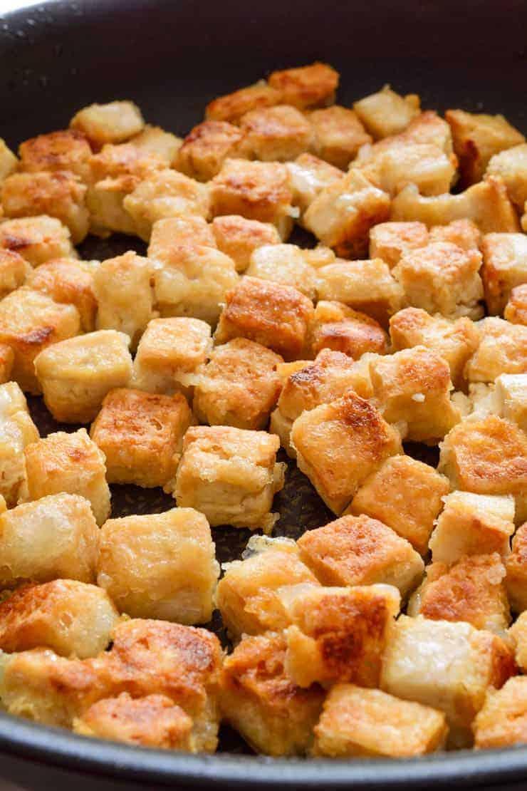A pan full of golden-brown crispy fried tofu.