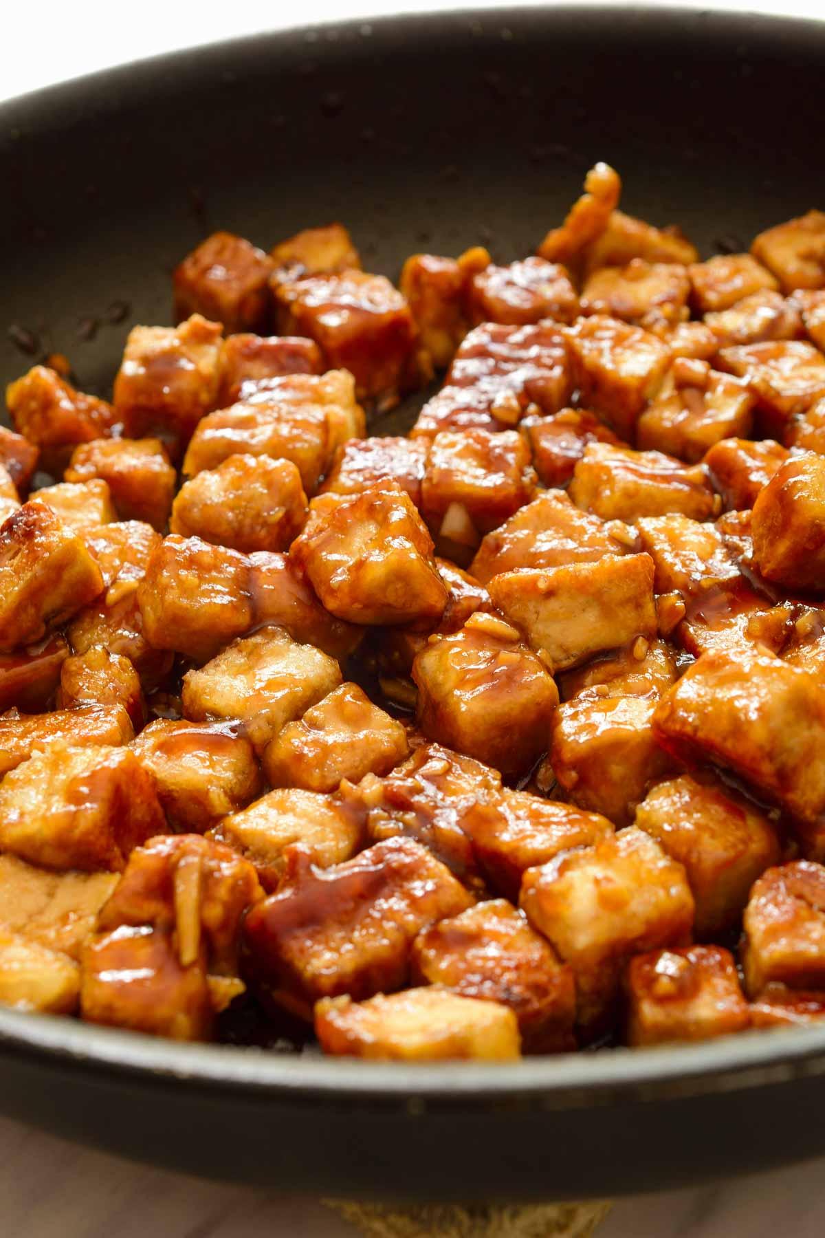 A pan full of teriyaki tofu.